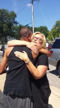Sen McCaskill hugs unidentified Back guy