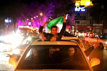 Celebration in Tehran after nuke deal announced (Ebrahim Noroozi/AP).