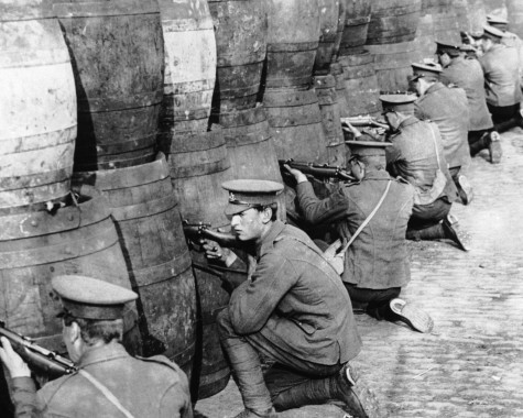 British soldiers sniping from behind a barricade of empty beer casks near the quays in Dublin during the 1916 Easter Rising.