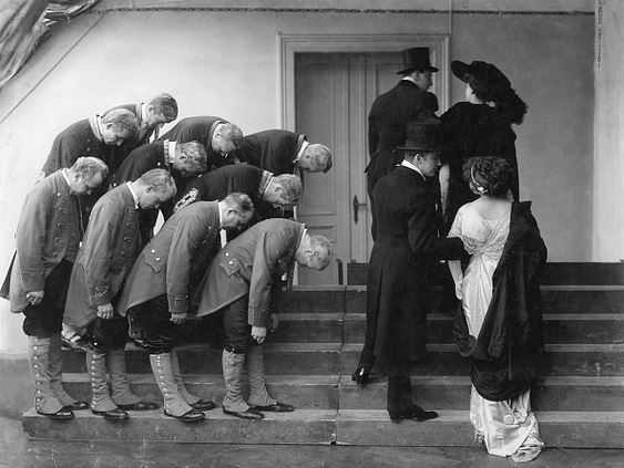 Servants Bowing to their betters
