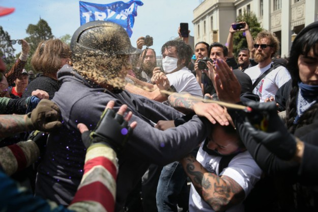 Pepper spray at pro-Trump Rally Attracts Anti-Trump at Berkeley riot.